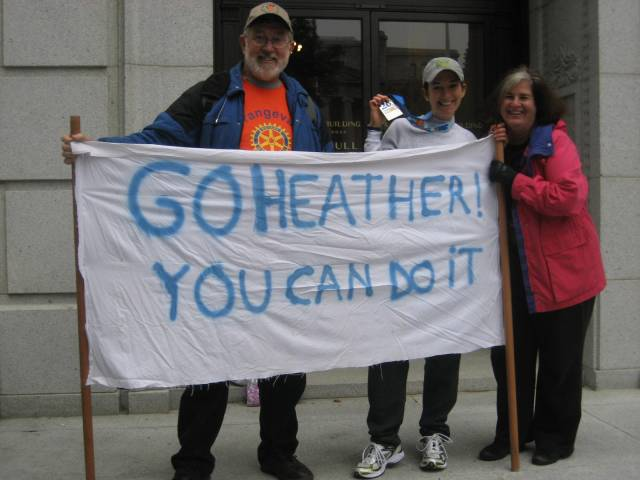 My parents and the now famous marathon sign